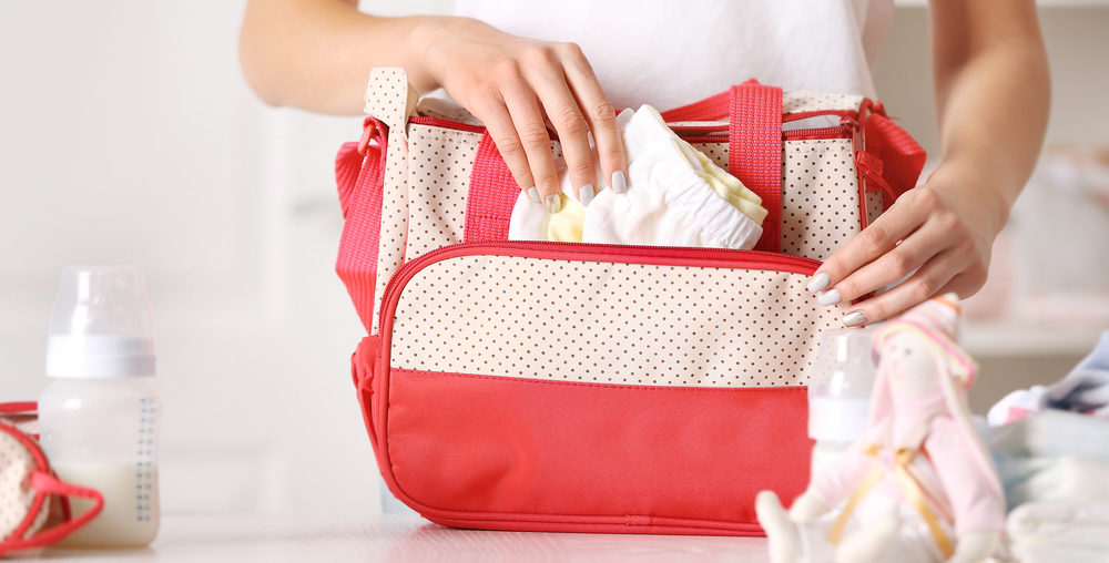 Woman cleaning her diaper bag