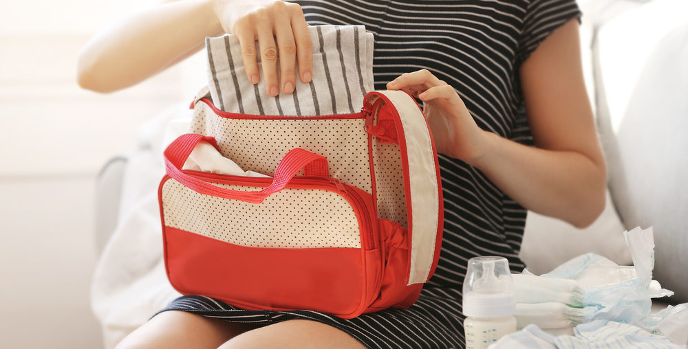Woman packing her diaper bag